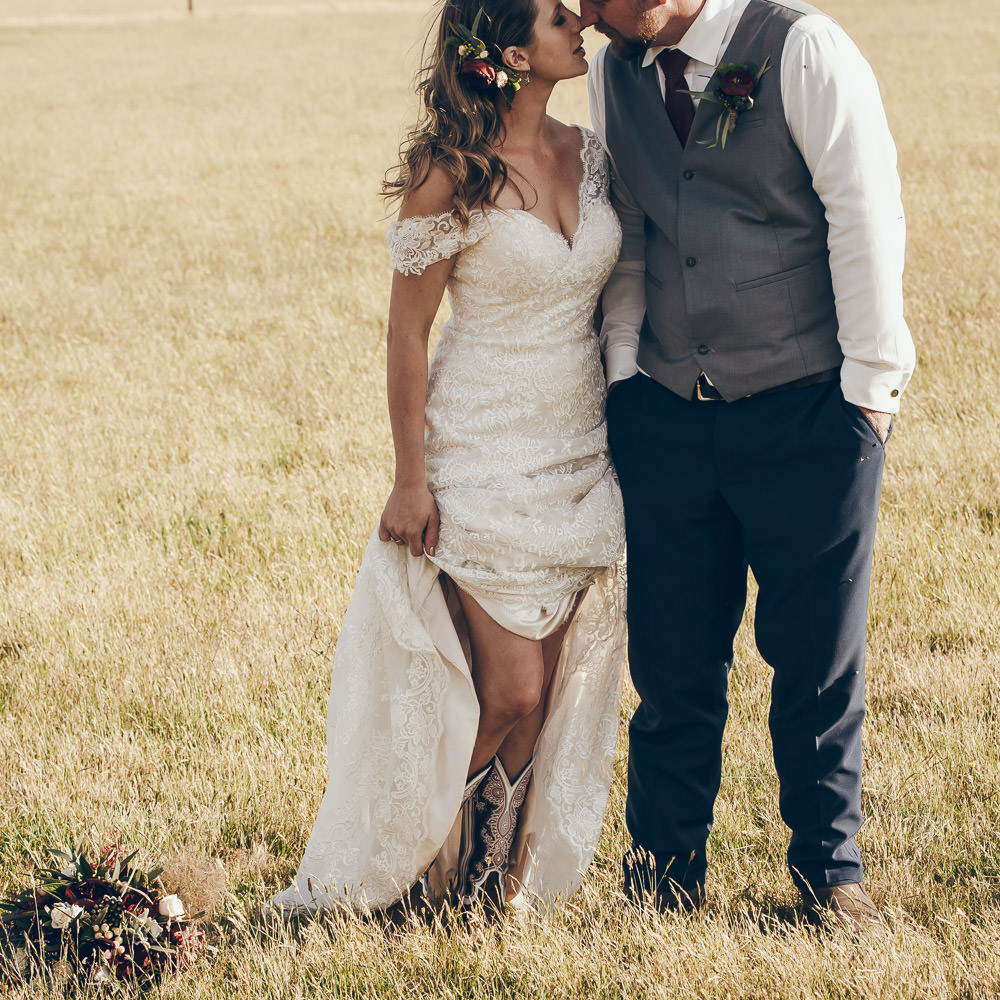 Sexy wedding photo, bride and groom in a field, country wedding, marquee on farm by Danae Studios