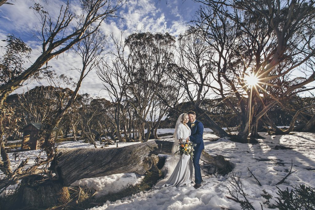 Rundells Alpine Lodge Wedding, Snow Wedding Photos, Beautiful Wedding Photos by Danae Studios, Bride and Groom Embracing