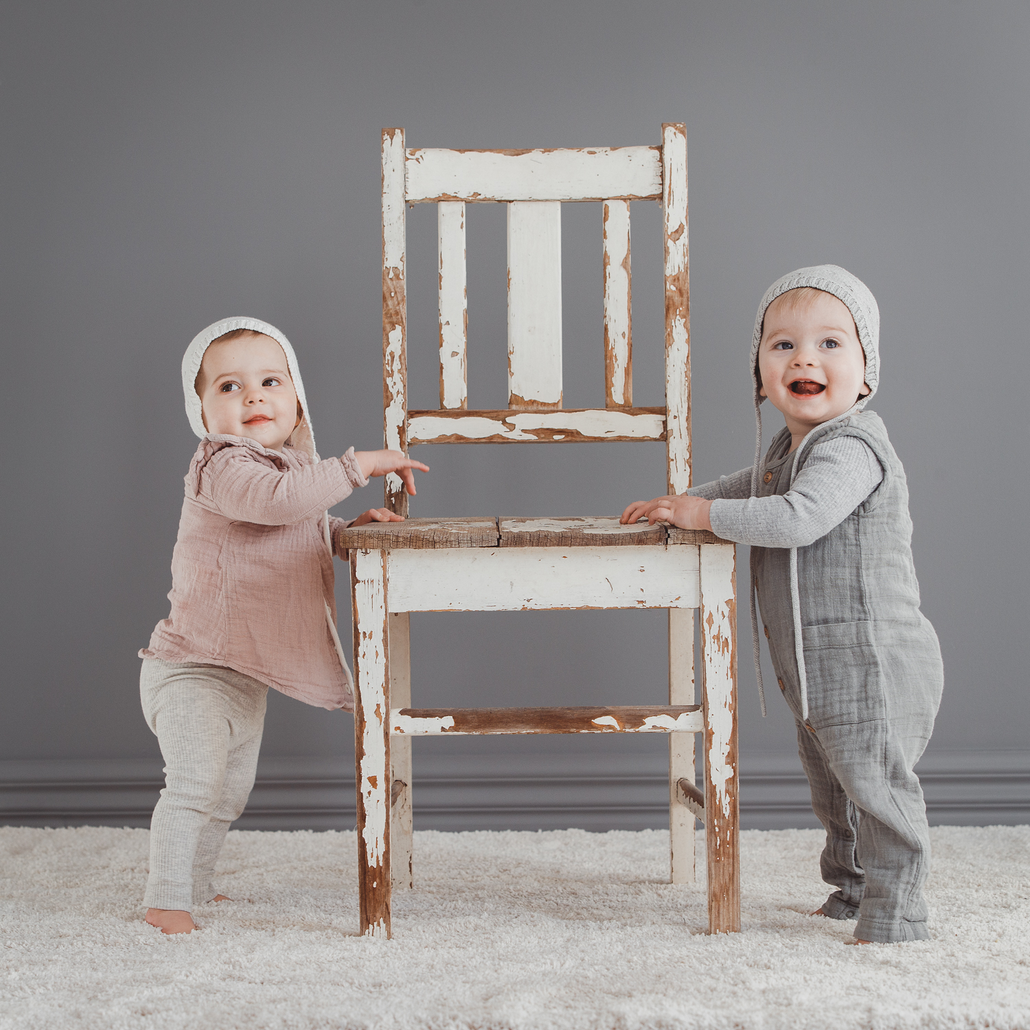 Twins studio shoot twin boy and girl wearing beanies and cute linen outfits to help raise funds for sands.org.au